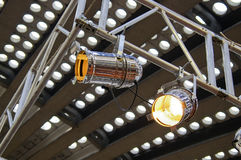 Reflectors. Two lighting reflectors tied to metal construction Stock Photo