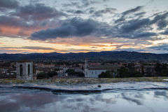 Reflects of the clouds in the puddle, Gubbio Stock Photo