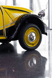 Reflects of an old sport car. Reflects of an old yellow sport car Stock Photos