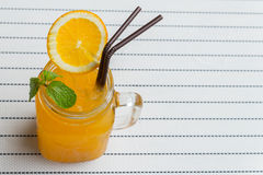 refleshing with Orange juice with ice in a glass on natural cott Stock Photo