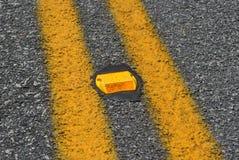Refletor alaranjado da estrada Fotos de Stock