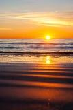 Reflexão de Sun na areia Imagens de Stock