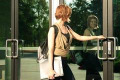 Reflexão do estudante na porta Foto de Stock Royalty Free