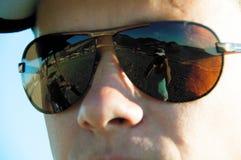 Reflexão do fotógrafo nos óculos de sol Fotografia de Stock Royalty Free
