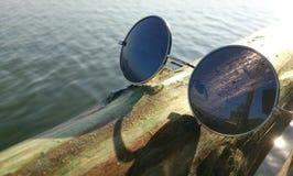 Reflexão do mar nos vidros Imagem de Stock