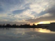 Reflexão do por do sol Fotografia de Stock