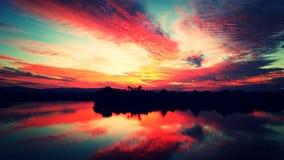 Reflexão dos pores do sol Fotografia de Stock