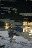 Reflexão na água no por do sol Fotografia de Stock