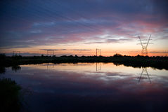 Reflexões e silhuetas no por do sol Fotos de Stock Royalty Free