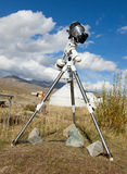 A reflex camera mounted on a tripod. Stock Image