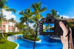 Reflex camera and tropical resort Stock Photos