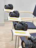 Reflex digital camera in classroom photoschool Royalty Free Stock Images