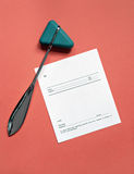 Reflex Hammer and Blank Script. Reflex hammer with blank prescription on coral background Stock Images