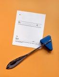 Reflex Hammer and Blank Script. Reflex hammer with blank prescription on orange background Royalty Free Stock Photo