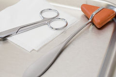 Reflex hammer scissors and gauze Stock Image