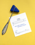 Reflex Hammer with Script. Reflex hammer with prescription for a months vacation to destination of choice or space for your own text Royalty Free Stock Image