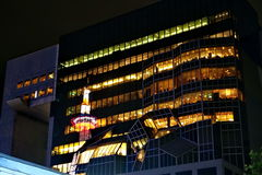 Reflex picture of Kyoto Tower on building. Stock Photo