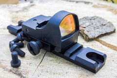 Reflex sight on the stump. Stock Photo