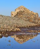Reflexes in the saltwater of old stone construction Stock Photo