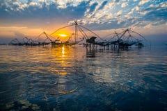 Reflexión de la pesca con salida del sol Imagenes de archivo