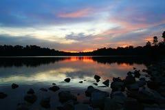 Reflexión de la puesta del sol Fotos de archivo libres de regalías