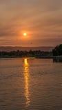 Reflexión de la puesta del sol Fotos de archivo