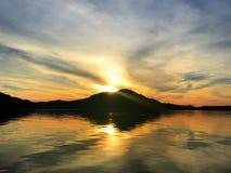 Reflexión de la puesta del sol Foto de archivo