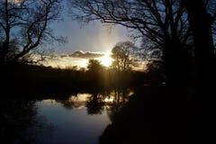 Reflexión de la puesta del sol Imagenes de archivo