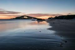 Reflexión de la puesta del sol Fotografía de archivo libre de regalías