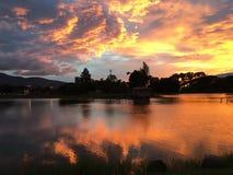 Reflexión de la puesta del sol y del agua Imagen de archivo