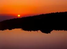 Reflexión de la salida del sol Imagen de archivo