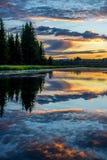Reflexión de la salida del sol en el parque nacional magnífico de Teton Imagen de archivo libre de regalías