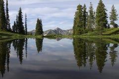 Reflexión de la salida del sol en la divisoria del paraíso, Colorado Foto de archivo