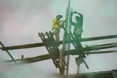Reflexión de los trabajadores de construcción Fotografía de archivo