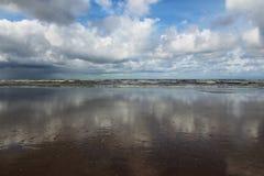 Reflexión del cielo en la playa Imágenes de archivo libres de regalías