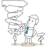 Reflexión del hombre de negocios que mira señales de tráfico Foto de archivo libre de regalías
