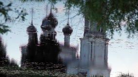 Reflexión del templo del cristianismo en agua Fotografía de archivo libre de regalías