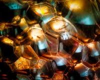 Reflexion av guld- organiska former och färger Royaltyfri Bild