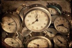Reflexion of clocks. Vintage alarm clocks with reflexion in mirrow, textured style Stock Photo