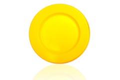 Reflexion des gelben Plastiktellers stockfoto