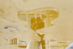 Reflexion of groom and bride Stock Photography