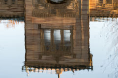 Reflexion of house in water with blue background. Reflexion of a house in water with blue background Stock Images
