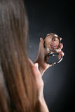 Reflexion of lips in a mirror. In a hand a mirror. In it reflexion of beautiful female lips Stock Images