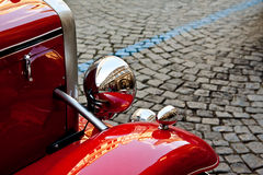 Reflexion in red retro car. On street of Prague Royalty Free Stock Images
