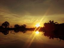 Reflexion sunset. I am taking this picture at trawas, mojokerto, indonesia when sunset Stock Photo
