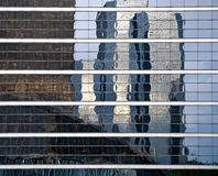 Reflexion in windows of modern building Stock Images