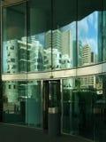 Reflexionen der Stadt Stockbilder