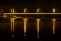 Reflexioner på natten från den Prienai bron Royaltyfria Foton