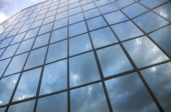 Reflexions in facade of modern building Stock Image