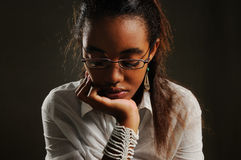 Reflexive teen girl. Portrait of teenage african woman with pensive expression Royalty Free Stock Photography